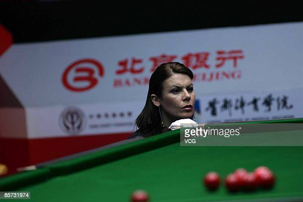 Snooker Match Referee Michaela Tabb checks on the position of the ball during the match between John Higgins of Scotland and Anthony Hamilton of...