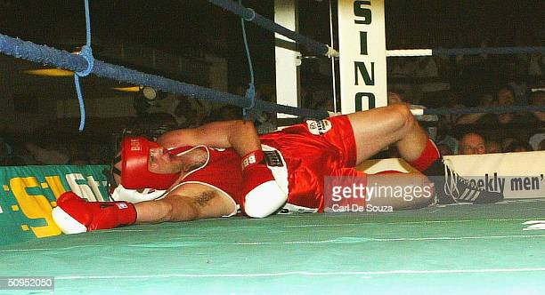 Snooker player Mark King lies knocked down during the Associationsanctioned fight of Quentin Hann v Mark King at York Hall on June 11 2004 in Bethnal...