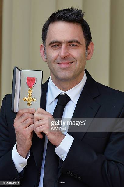 Snooker player Ronnie O'Sullivan poses with his partner Laila Rouass after receiving an OBE from the Prince of Wales at an investiture ceremony at...