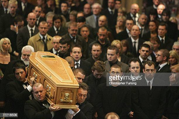 Snooker player Steven Hendry and other players look on as the coffin of snooker star Paul Hunter arrives at Leeds Parish Church during his funeral on...