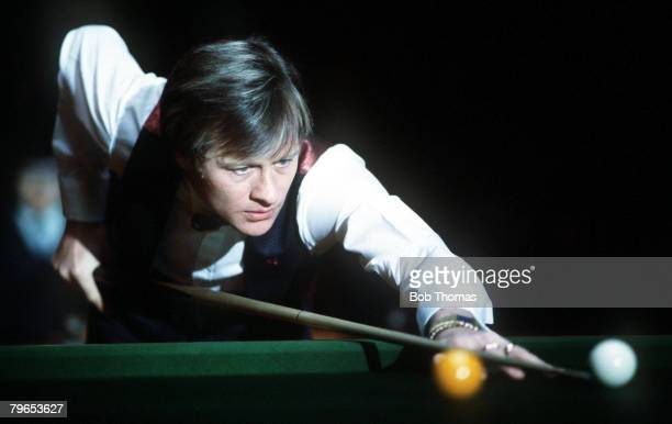 Snooker Wembley, London, Benson & Hedges Masters, Alex Higgins of Northern Ireland, lines up a shot