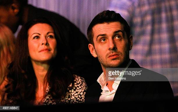 Snooker World Champion Mark Selby and his wife Vicki look on during the McCoys Premier League Darts PlayOffs Semi Final match between Michael van...