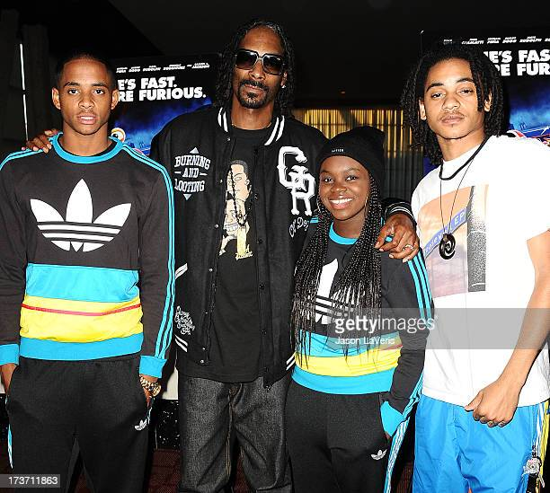 Snoop Dogg aka Snoop Lion and children Cordell Broadus Cori Broadus and Corde Broadus attend a screening of Turbo at ArcLight Hollywood on July 16...
