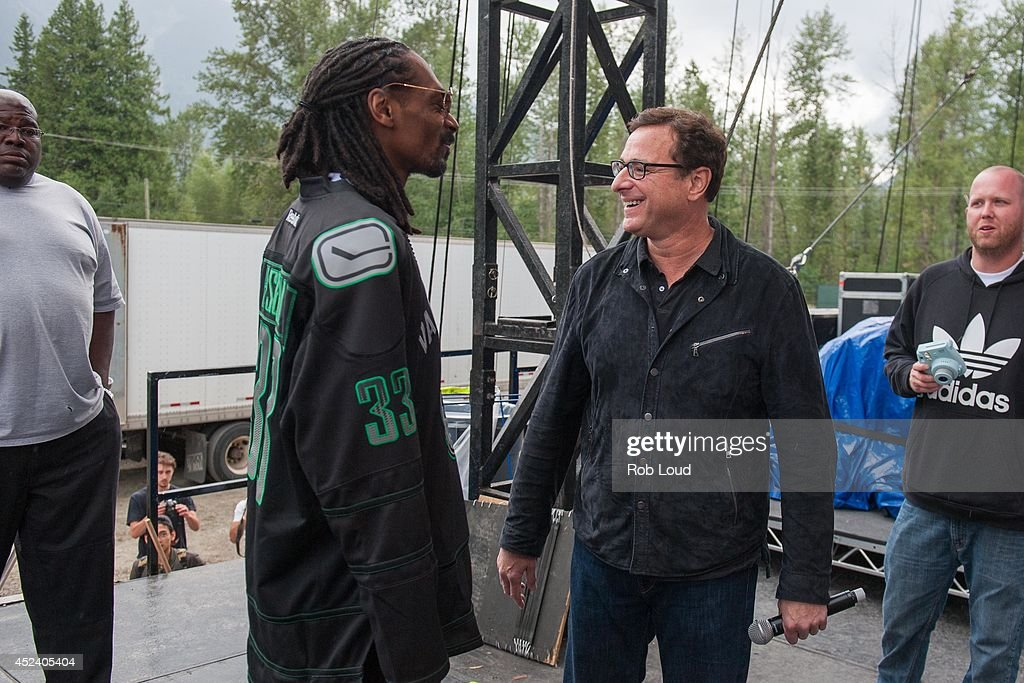 Snoop Dogg and Bob Saget talk backstage at the Pemberton Music Festival on July 19, 2014 in Pemberton, Canada.
