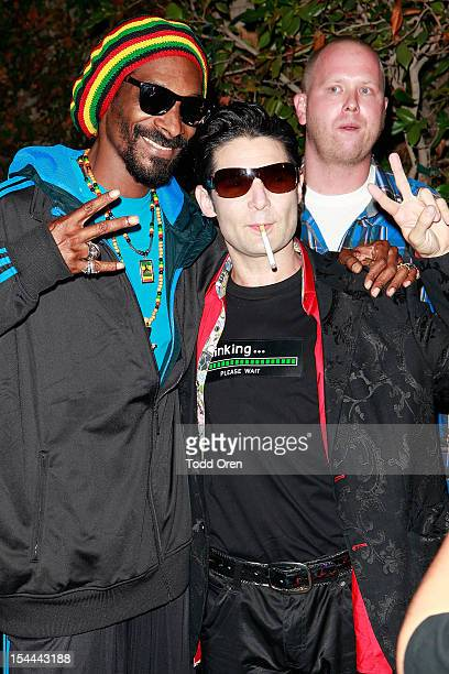 Snoop Dogg and Corey Feldman pose at the Snoop Dogg Presents Colt 45 Works Every Time at The Playboy Mansion Party with Evan and Daren Metropulos on...