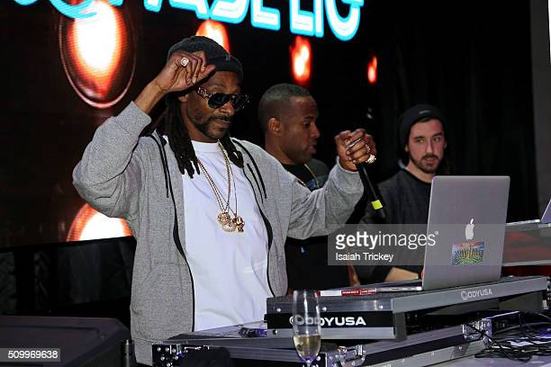 Snoop Dogg and DJ Whoo Kid attend the 2016 NBA AllStar Weekend Maxim Party at Muzik on February 12 2016 in Toronto Canada