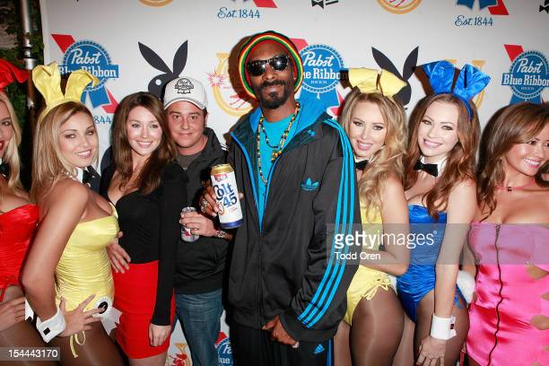 Snoop Dogg and Evan Metropoulos pose at the Snoop Dogg Presents Colt 45 Works Every Time at The Playboy Mansion Party with Evan and Daren Metropulos...