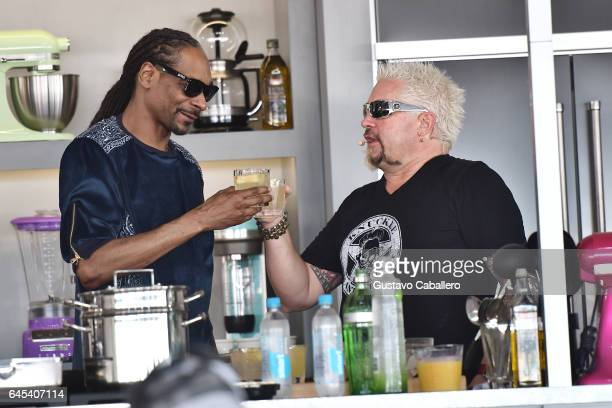 Snoop Dogg and Guy Fieri cook on stage at Goya Foods' Grand Tasting Village Featuring Mastercard Grand Tasting Tents KitchenAid Culinary...