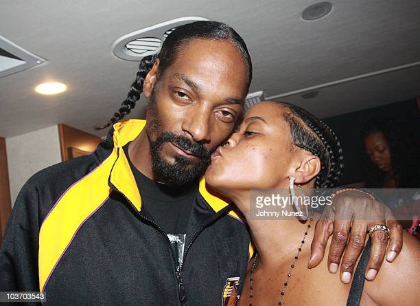 Snoop Dogg and his wife Shante Broadus attend the 7th Annual Rock The Bells festival on Governors Island on August 28 2010 in New York City