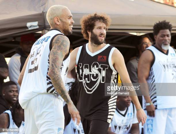 Snoop Dogg and Lil Dicky play basketball during the East Vs West game at adidas Creates 747 Warehouse St an event in basketball culture on February...