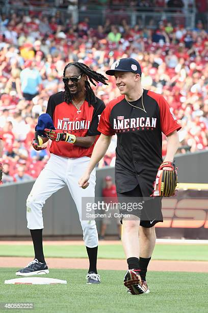 Snoop Dogg and Macklemore attends the 2015 MLB AllStar Legends And Celebrity Softball Game at Great American Ball Park on July 12 2015 in Cincinnati...