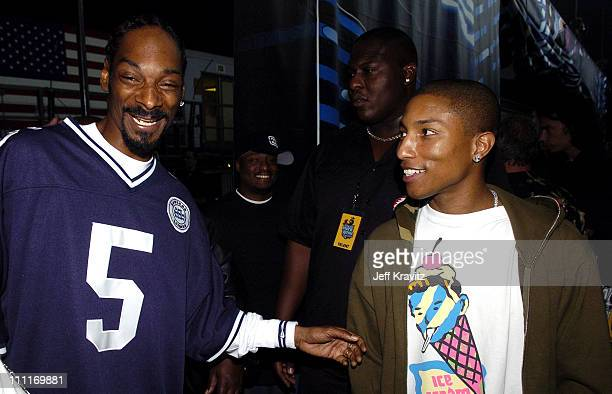 Snoop Dogg and Pharrell Williams during Spike TV's 2nd Annual Video Game Awards 2004 Backstage at Barker Hangar in Santa Monica California United...