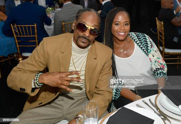Snoop Dogg and Shante Broadus attend the 33rd Annual CedarsSinai Sports Spectacular at The Compound on July 15 2018 in Inglewood California