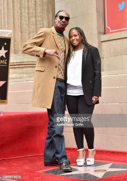 Snoop Dogg and Shante Broadus attend the ceremony honoring Snoop Dogg with star on the Hollywood Walk of Fame on November 19 2018 in Hollywood...