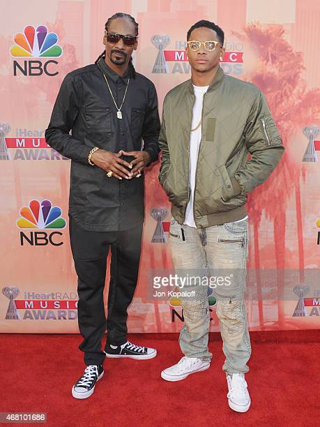 Snoop Dogg and son Cordell Broadus arrive at the 2015 iHeartRadio Music Awards at The Shrine Auditorium on March 29 2015 in Los Angeles California