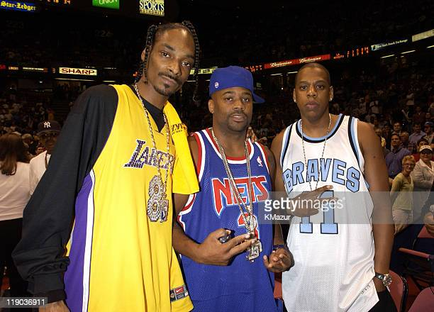 Snoop Dogg Damon Dash and JayZ during Celebrities at Game 4 of the NBA Finals with the Los Angeles Lakers and the New Jersey Nets at Continental...