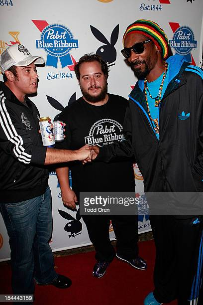 Snoop Dogg Evan Metropoulos and Daren Metropoulos pose at the Snoop Dogg Presents Colt 45 Works Every Time at The Playboy Mansion Party with Evan and...
