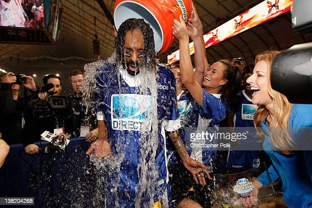 Snoop Dogg of team Palladia gets dumped with Gatorade after the HD DIRECTV's Sixth Annual Celebrity Beach Bowl Game at Victory Field on February 4,...