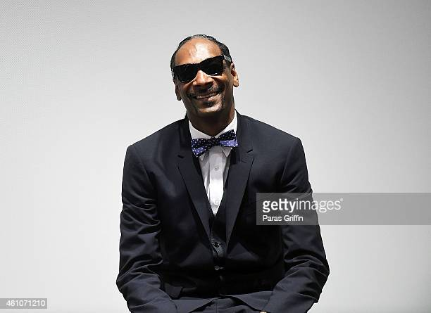 Snoop Dogg onstage at 'Snoop Son A Dad's Dream' Atlanta Screening at College Football Hall of Fame on January 5 2015 in Atlanta Georgia