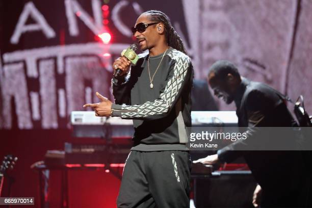 Snoop Dogg performs in honor of 2017 Inductee Tupac Shakur onstage at the 32nd Annual Rock Roll Hall Of Fame Induction Ceremony at Barclays Center on...