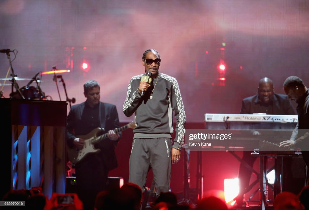 Snoop Dogg performs in honor of 2017 Inductee Tupac Shakur onstage