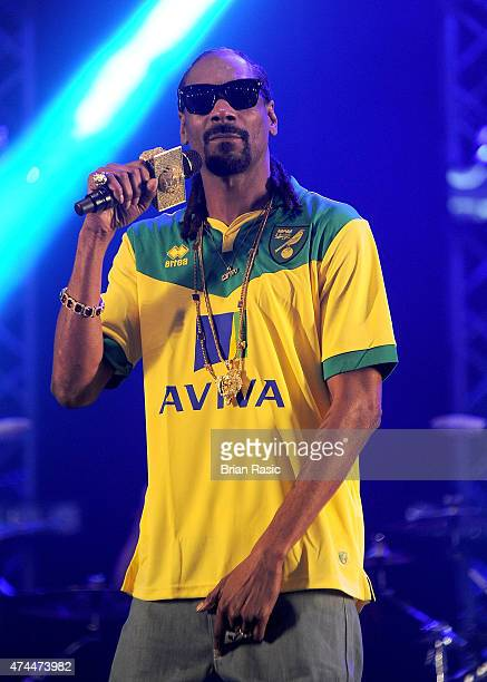Snoop Dogg performs on stage wearing a Norwich City FC football shirt during day one of BBC Radio 1's Big Weekend at Earlham Park on May 23 2015 in...