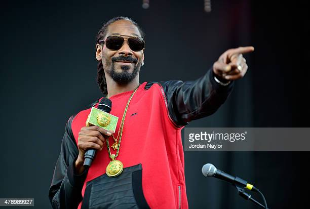 Snoop Dogg performs onstage at the SXSW Outdoor Stage at Butler Park during the 2014 SXSW Music Film Interactive Festival at Butler Park on March 15...