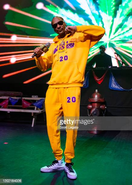 Snoop Dogg performs, while wearing a Los Angeles Lakers sweat suit in memory of Kobe Bryant, at The Fillmore on January 26, 2020 in Detroit,...