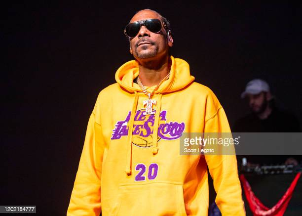 Snoop Dogg performs while wearing a Los Angeles Lakers sweat suit in memory of Kobe Bryant at The Fillmore on January 26 2020 in Detroit Michigan...