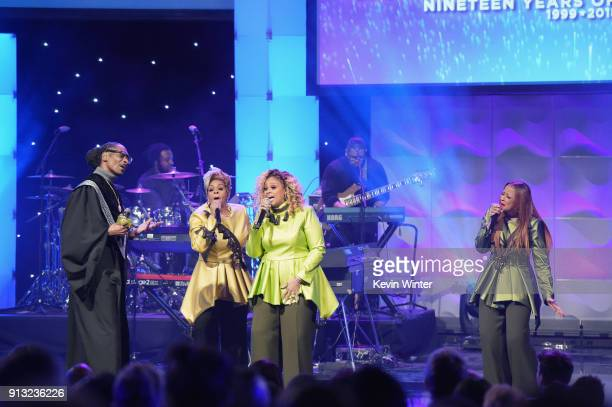 Snoop Dogg performs with Jacky ClarkChisholm Dorinda ClarkCole and Karen Clark Sheard of The Clark Sisters onstage during BET Presents 19th Annual...