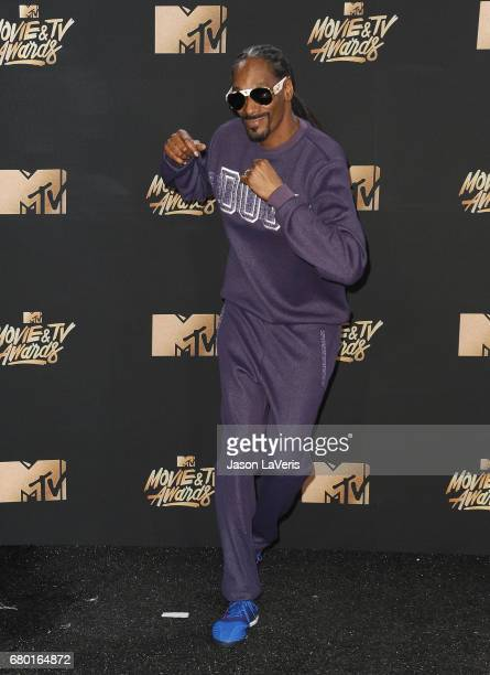 Snoop Dogg poses in the press room at the 2017 MTV Movie and TV Awards at The Shrine Auditorium on May 7 2017 in Los Angeles California