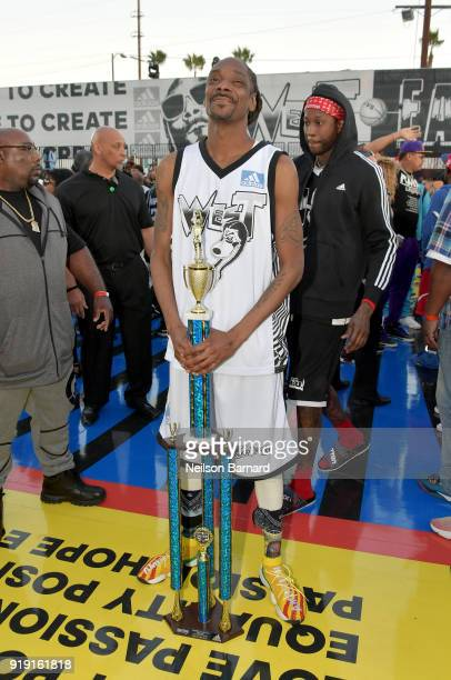 Snoop Dogg poses with the trophy after the East Vs West game at adidas Creates 747 Warehouse St an event in basketball culture on February 16 2018 in...