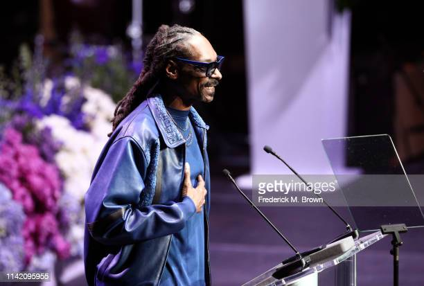 Snoop Dogg speaks onstage during Nipsey Hussle's Celebration of Life at STAPLES Center on April 11 2019 in Los Angeles California Nipsey Hussle was...