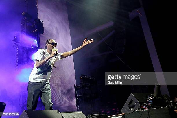 Snoop Dogg throws a blunt into the crowd as he performs in concert with Wiz Khalifa on the High Road Tour at the Austin360 Amphitheater on August 21,...