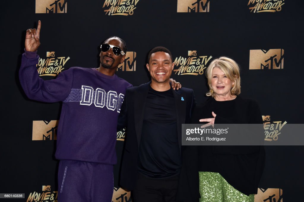 Snoop Dogg, tv personality Trevor Noah, winner of Best Host for 'The Daily Show', and Martha Stewart pose in the press room during the 2017 MTV Movie And TV Awards at The Shrine Auditorium on May 7, 2017 in Los Angeles, California.