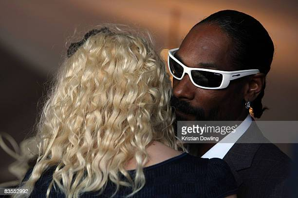 Snoop Dogg whispers in the ear of a fan in the Lavazza Marquee during Emirates Melbourne Cup Carnival 2008 at Flemington Race Course on November 4...
