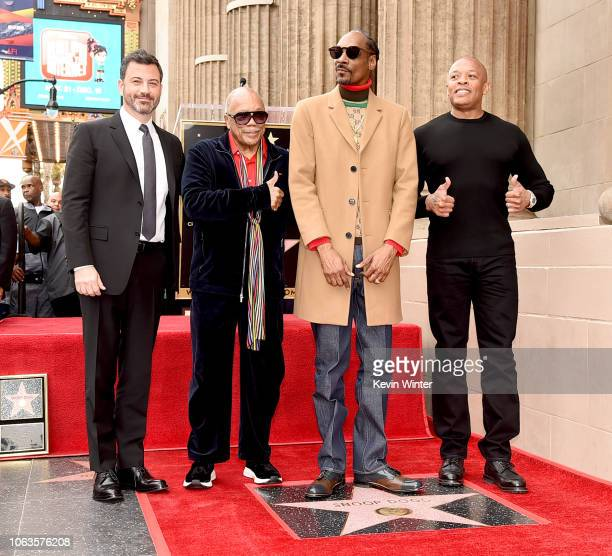 Snoop Dogg with Jimmy Kimmel Quincy Jones and Dr Dre is honored with a star on The Hollywood Walk Of Fame on Hollywood Boulevard on November 19 2018...