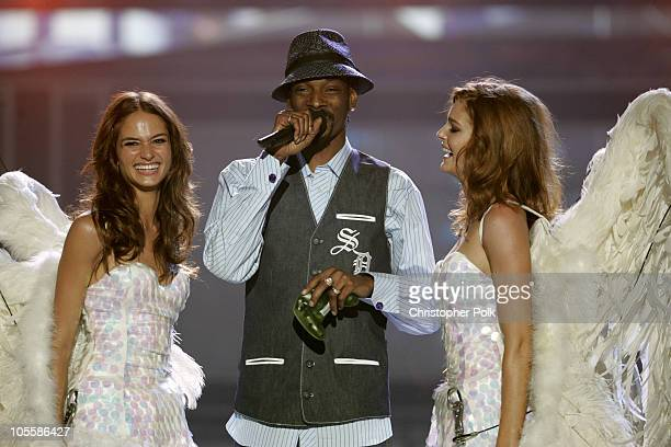 Snoop Dogg with Presenter Angels during Spike TV's 2nd Annual Video Game Awards 2004 Show Hosted by Snoop Dogg at Barker Hangar in Santa Monica...