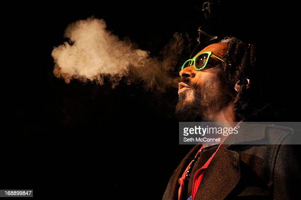 Snoop Lion exhales a heart shaped cloud of marijuana smoke while doing a QA with the audience after the screening of his documentary Reincarnated...