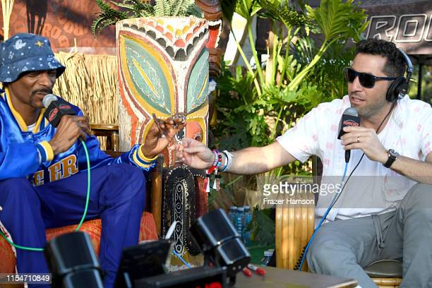 Snoopadelic and Klein attend KROQ Weenie Roast Luau at Doheny State Beach on June 08 2019 in Dana Point California