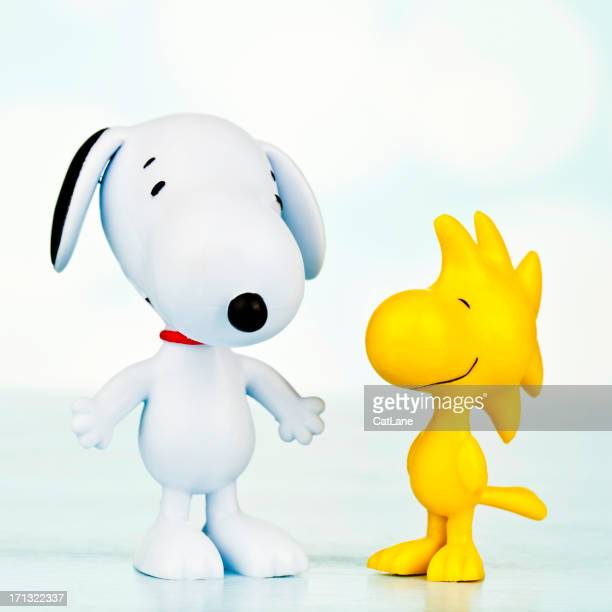snoopy and woodstock - funny cartoon stock photos and pictures