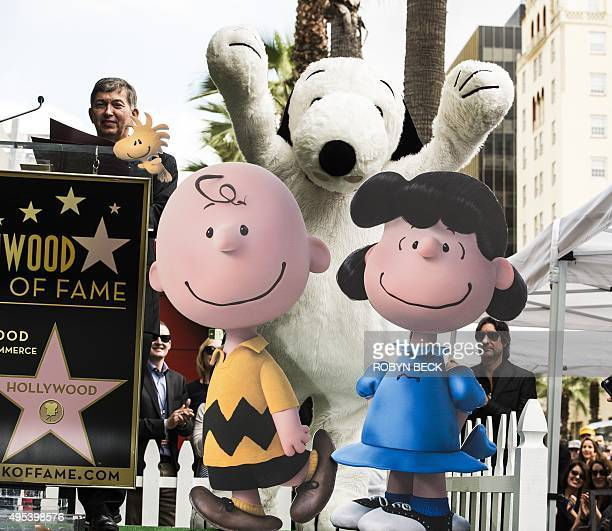 Snoopy celebrates at his star unveiling ceremony on the Hollywood Walk of Fame November 2 2015 in Hollywood California At left is Hollywood Chamber...