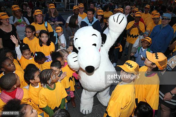 Snoopy from 'The Peanuts Movie' mingles with school children at NASDAQ Closing Bell at NASDAQ MarketSite on November 3 2015 in New York City