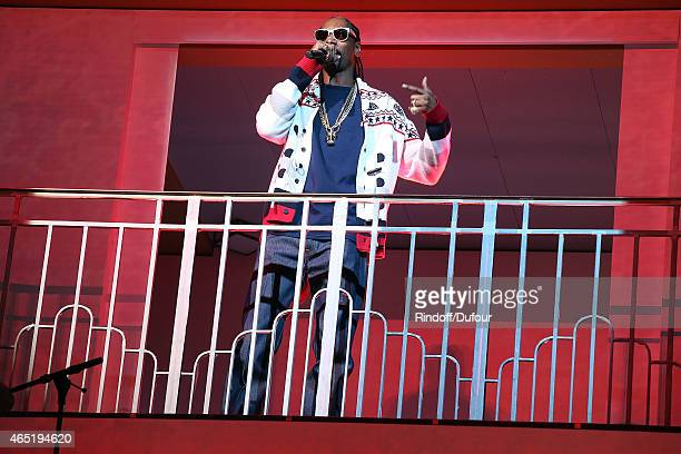 Snopp Dogg performs during the ETAM show as part of the Paris Fashion Week Womenswear Fall/Winter 2015/2016 at Piscine Molitor on March 3 2015 in...