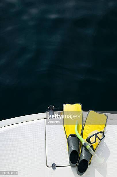 Snorkel mask and flippers on a yacht