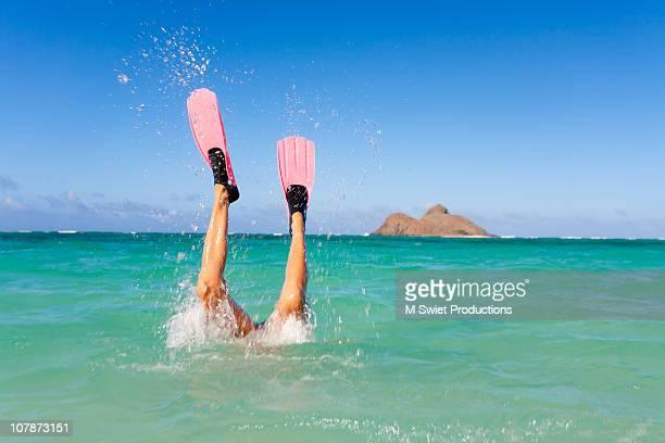 Snorkeler diving fun