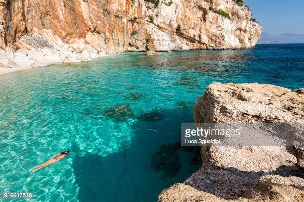 snorkeling at cala mariolu beach - sardinia stock pictures, royalty-free photos & images