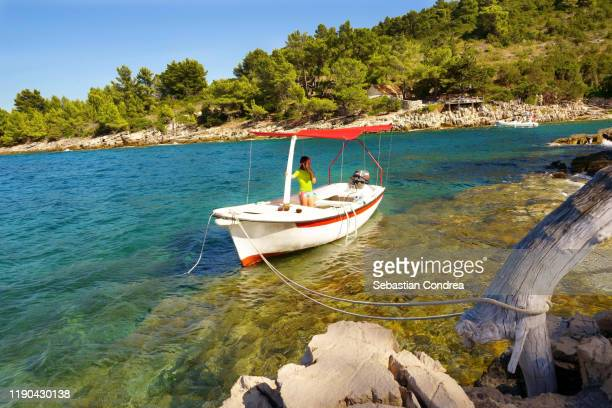 snorkeling girl alone by boat, on the beautiful island of jelsa, dalmatia, croatia travel, discovery europe - croatia stock pictures, royalty-free photos & images