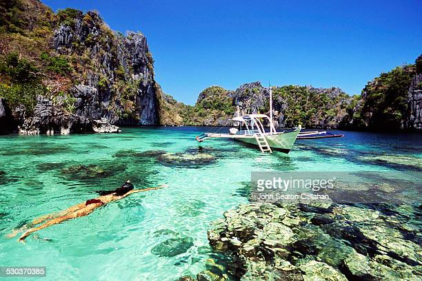 snorkeling in miniloc lagoon - el nido stock pictures, royalty-free photos & images