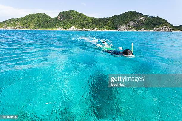Snorkeling in the blue clear waters
